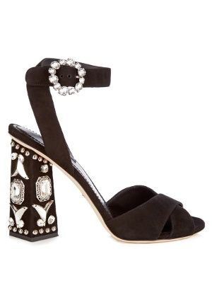 Dolce & Gabbana's Resort 2017 collection is inspired by the joy of movement, and these black suede sandals are made to dominate the dance floor. They're set on a high hexagonal-shaped heel, and encrusted with a treasure trove of sparkling silver-tone metal and crystal embellishments. Wear them at night with tailored monochrome separates.