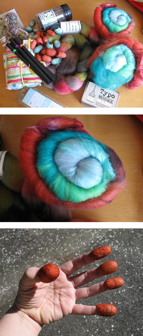 Sourkraut from Lahmalo: chocolate ginger, pens which will work on wood(!!!) delicious braid of fibre, poufy soft batts- (which are begging to be a gradient) some cocoons- (I don't know what I will do with these yet- but they are fascinating.)   There was also a gorgeous skein of Sari silk. The colours are beautiful. Also some excellent note cards - In a tin! and some lovely little sticky tags for marking magazine pages.   It was a great parcel- really well tailored for me.