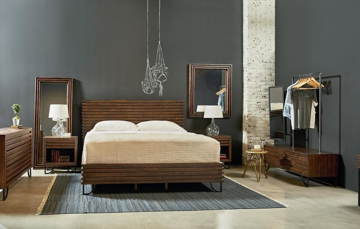 This bold square Boho Stacked Slat Queen Bed has an upcycled look with its horizontal crate style slats and distressed Barn Door finish. It has a low-profile slatted footboard and side rails, and is supported by retro-style metal legs. Customer assembly required. Magnolia Home designed by Joanna Gaines.