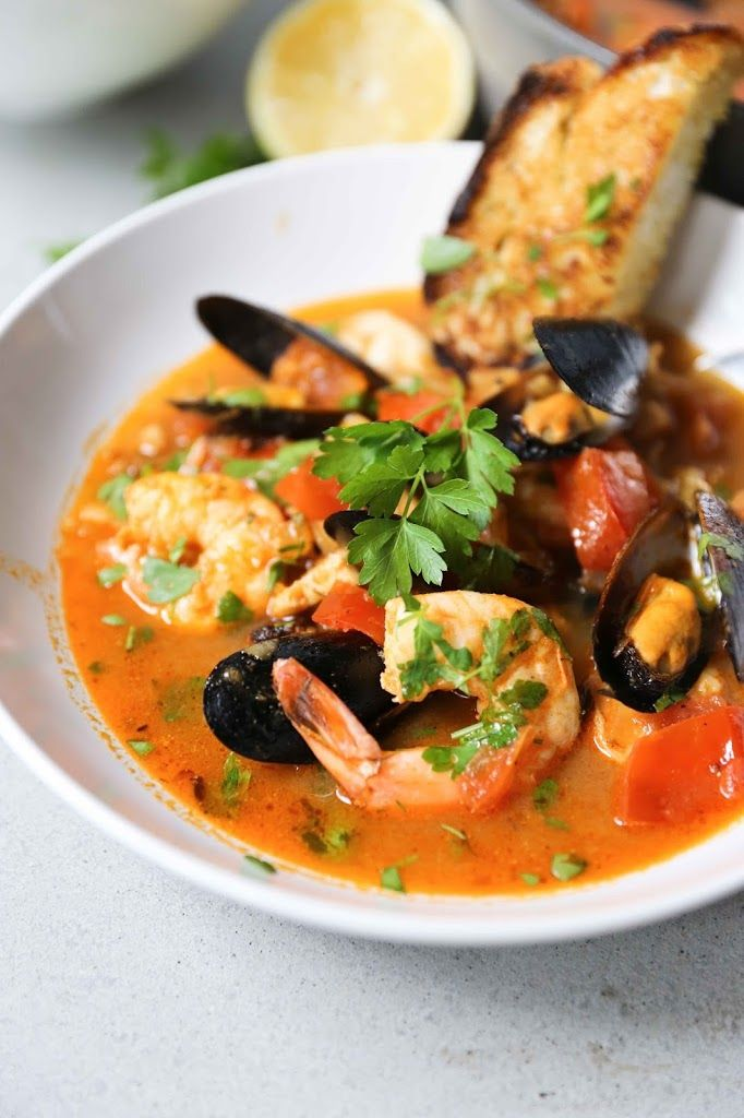 A summery seafood stew…. light, bright and full of flavor. Click through for recipe!