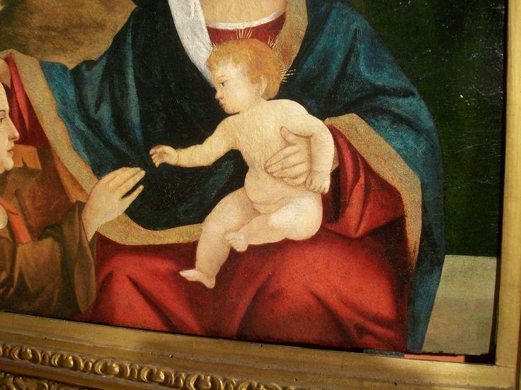 MADONNA CON BAMBINO E SANTO. Olio su tavola della metà del cinquecento, Venezia, misure cm. 50x37, completo di cornice cm. 75x64.