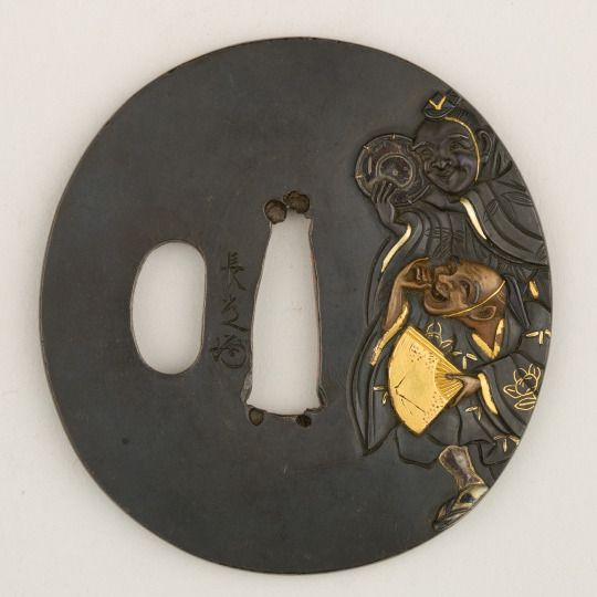 Sword Guard (Tsuba), 18th century...Japanese Shakudō, gold, silver, copper....Metropolitan Museum of Art