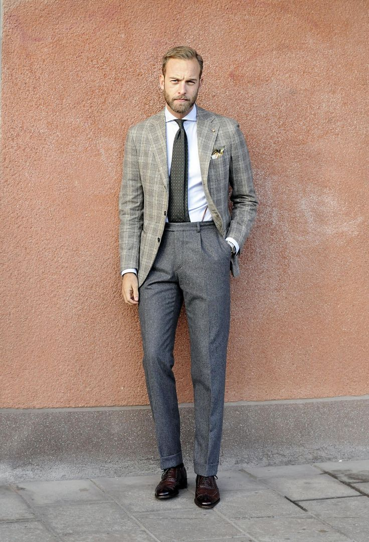 Classic grey flannel trousers designed by Manolo, cut with fabric from Vitale Barberis Canonico. Available at Ströms in Stockholm.