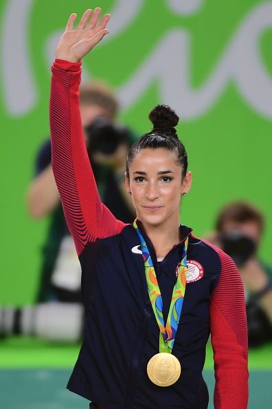 #RIO2016 US gymnast Alexandra Raisman celebrates on the podium during the women's team final Artistic Gymnastics at the Olympic Arena during the Rio 2016...