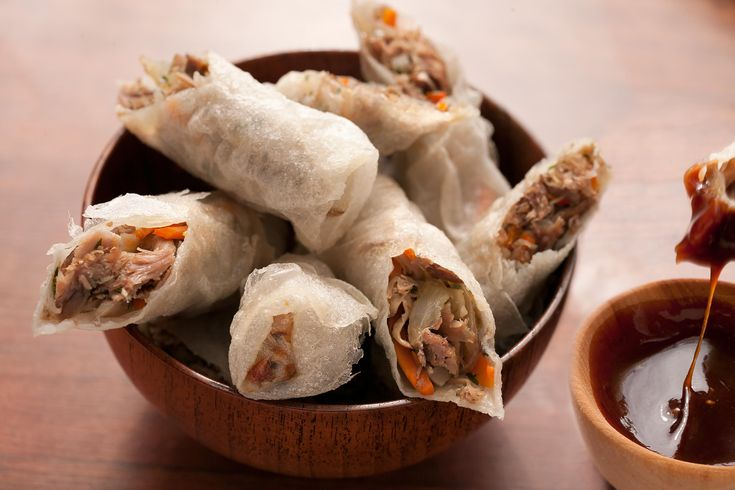 This recipe for duck confit fried spring rolls has duck confit, carrots, water chestnuts, and mushrooms wrapped in rice paper and a hoisin-plum dipping sauce.