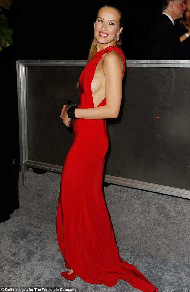 Peek a boob! Petra Nemcova, 37, set pulses racing on Sunday as she arrived at a Golden Globes After Party in a slinky scarlet number, which flashed a saucy hint of side boob