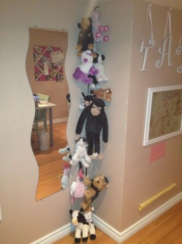 DIY stuffed animal holder using ribbon & clothes pins. I made this for Lily's room. I wasn't able to thread the clothes pins with bobby pins as they suggested, so I used scotch tape on the end of the ribbon (like a shoelace tip) to push the ribbon through.