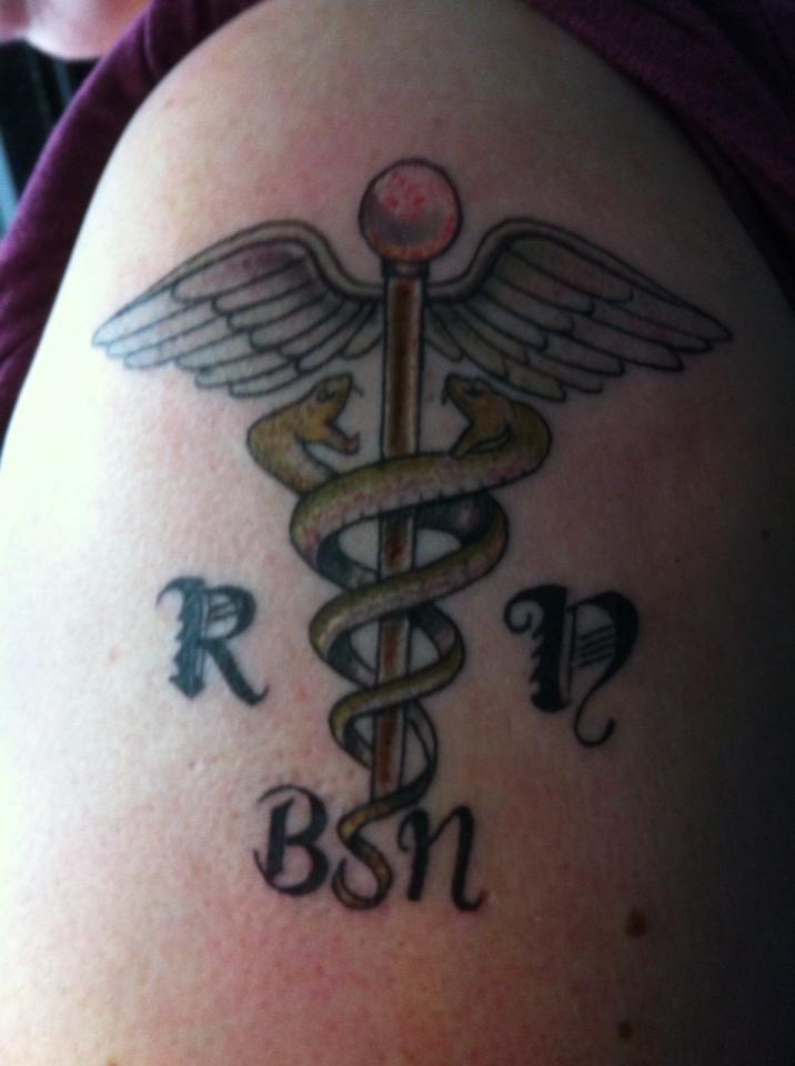 RN/BSN tattoo left upper arm