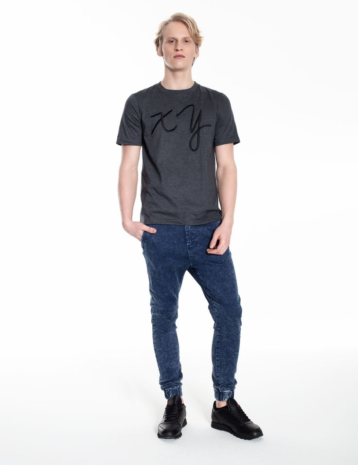 Model is wearing: XY chromosomes t-shirt in grey & blue denim Universum jeans