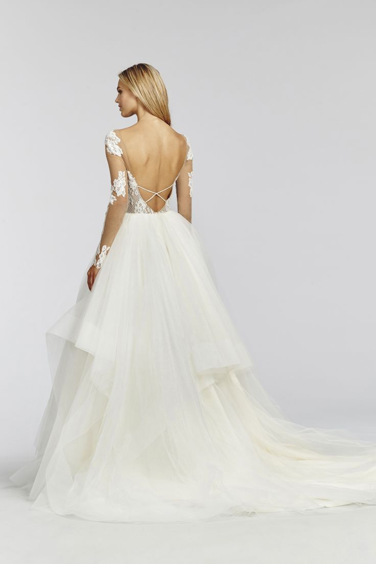 Pippa- 1652 Ivory lace and tulle ball gown, illusion bateau neckline with sweetheart lining, low open back with crisscross strap detail, cascading tulle skirt with horsehair trim.