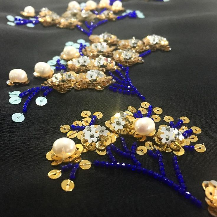 Shimmering gold and blue floral bunches with lapis blue French beaded stems on black dupion - #MuseLuxeLove