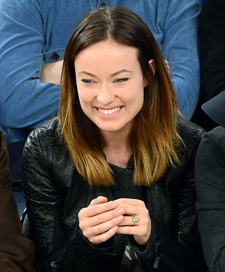Olivia Wilde's engagement ring from Jason Sudeikis is a 6-carat emerald-encircled gem, which he proposed with in Jan. 2013