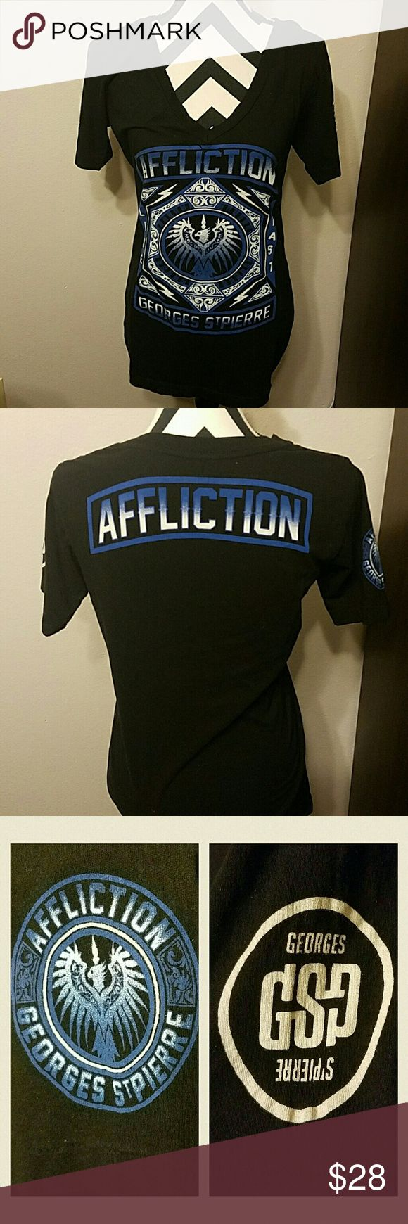 Affliction Georges St. Pierre UFC 158 prestige walkout tshirt for women in blue and black.  The 3rd pic shows emblems on side sleeves.  EUC, only worn that night.  Tags: ufc, mma, affliction, sinful, miss me Affliction Tops