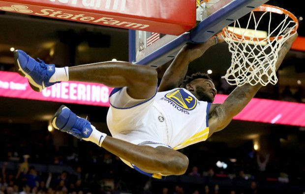 Golden State Warriors' Jordan Bell (2) hangs from the rim after dunking the ball in the third period of their NBA game against the Utah Jazz at Oracle Arena in Oakland, Calif., on Wednesday, Dec. 27, 2017. (Anda Chu/Bay Area News Group)