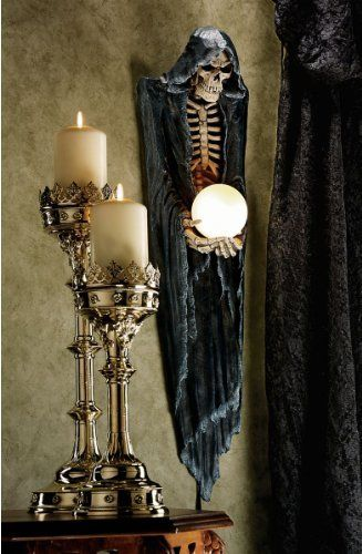 The Grim Reaper Illuminated Wall Sculptu by Design Toscano. $99.95. Cast in quality designer resin. Design Toscano exclusive. Hand painted. Personifying the awe-inspiring mythic creature who has skulked along the fringes of every culture since ancient times, artist Gary Chang's Grim Reaper wraps himself in a hooded, midnight black gown to offer your future in his bony hands. At nearly a yard tall, he's quite a distinctive sculptural presence on any wall, yet he best...