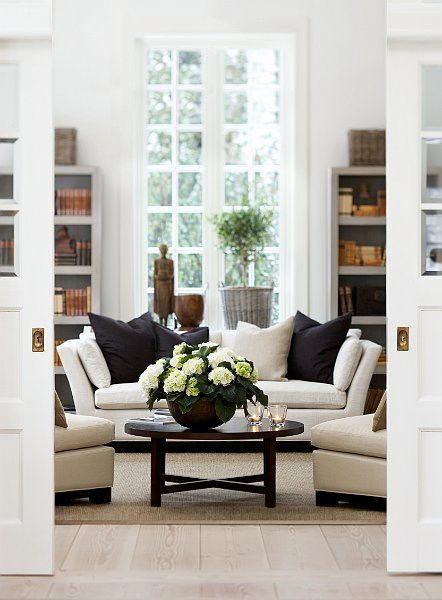 I love the French doors in this living room.: The Doors, Living Rooms, Living Spaces, Color, Coff Tables, Pocket Doors, Sit Rooms, Pillows, Sliding Doors