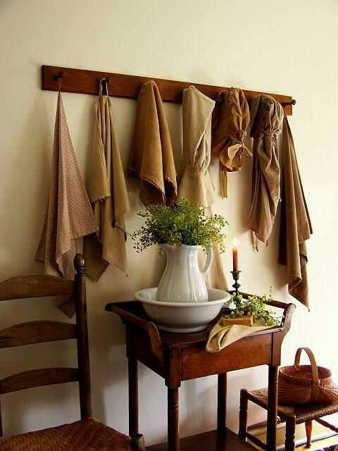 washstand, bowl and pitcher, ladderback chair, peg rack with clothes, stool with…