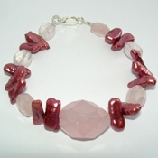 Hand made bracelet from Rose Quartz and Coral.