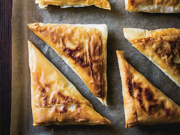 Tuna Briks | This best-ever Tunisian tuna brik recipe gets flavor from harissa, capers and scallions. Get the recipe from Food & Wine.
