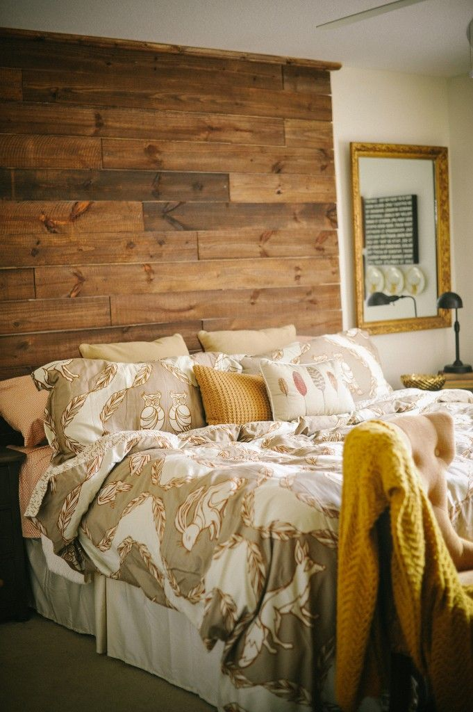 DIY wood headboard, love that it goes all the way to the ceiling!
