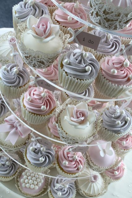 Vintage pink and lilac cupcake display #wedding #weddingcupcakes #cupcaketower #vintage #cupcakes