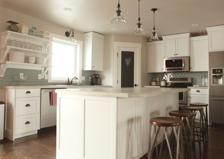 I like the shelves & the pantry door, but with white subway tile backsplash & different color flooring