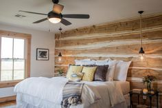 The renovated master bedroom included restored original hardwood floors and a new accent wall with rough milled cedar planks for a decidedly country look.