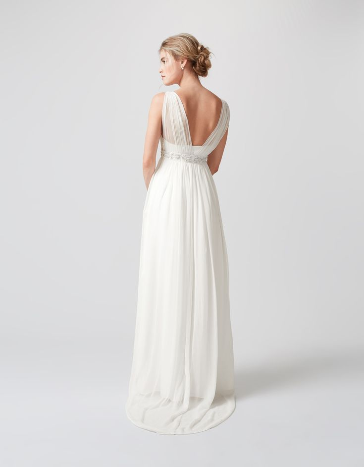 Channel boho romance in our ethereal Lucia ivory wedding dress. In a sheer crinkle fabric, this flowing design features gathered shoulders and sparkling embe...