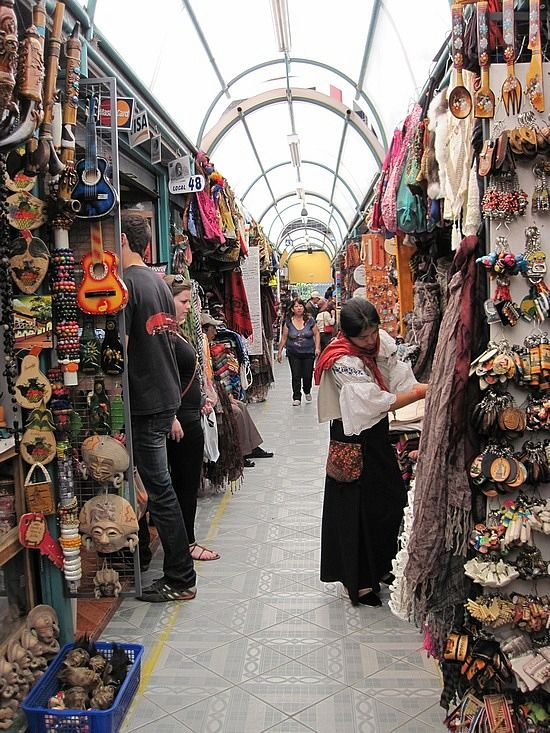 Beautifully dressed indigenous people sell their goods at Mercado en Quito, Ecuador. yes, please!