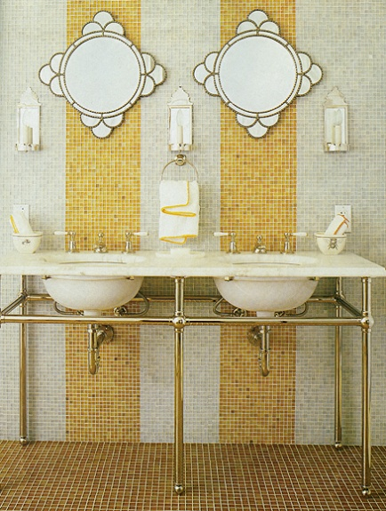 Gorgeous Gold & White bathroom with his and hers sinks.