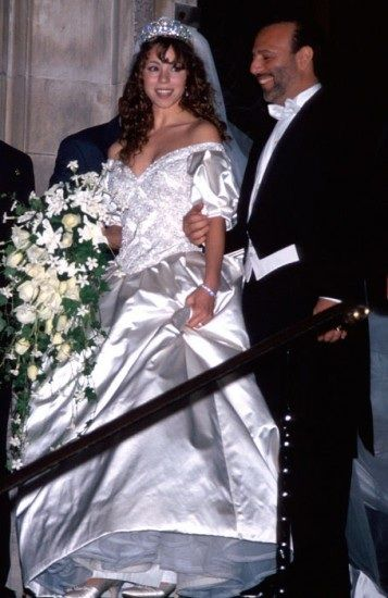 "When Mariah Carey married her first husband, music producer Tommy Mottola, she wore a $25,000 Vera Wang gown that was hand embroidered with sequins and 10,000 pearls. She also had a 27-foot-long train, reminiscent of Princess Diana's that had to be carried by six ""ladies in waiting"". In addition to her big wedding dress, Mariah also carried a floral bouquet was about as big as her whole ensemble."