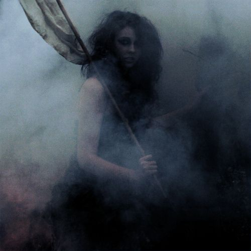 She bore the white flag, but had no intention of surrendering. It was a spear and, as the mist rose, her grip tightened around the wood as she readied herself to make full use of it.