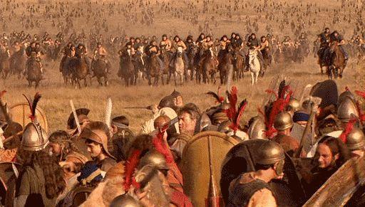 Os figurantes guerreiros que fazem cócegas uns nos outros