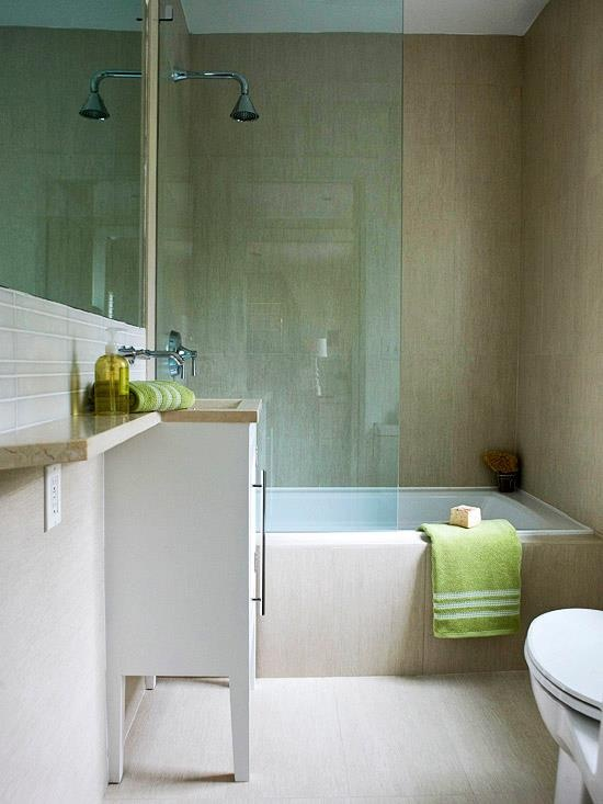 Simple bathroom with tub and glass shower,