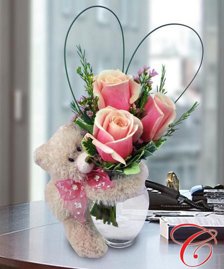 """""""Bear Hugs & Kisses."""" Three sweet roses in a glass bud vase arrive with a soft, plush bear. Bear size and color may vary. Roses available in red, yellow, pink, peach, and white."""