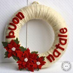 hobby-di-carta.blogspot.com ghirlanda natalizia fai da te/realizzata con filo e feltro