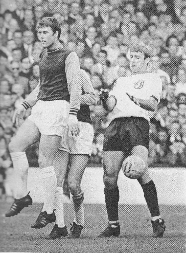 20th April 1968. West Ham centre forward Geoff Hurst shadowed by his World Cup strike partner, Liverpool's Roger Hunt.