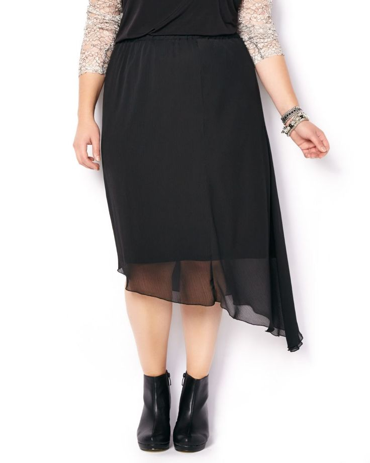 Give this fun and feminine plus-size skirt a whirl! Features a flowing asymmetric hem and comfortable elastic waistband. Team it with a solid-coloured top and heels for a look that'll take you from desk to drinks! #penningtons #holiday