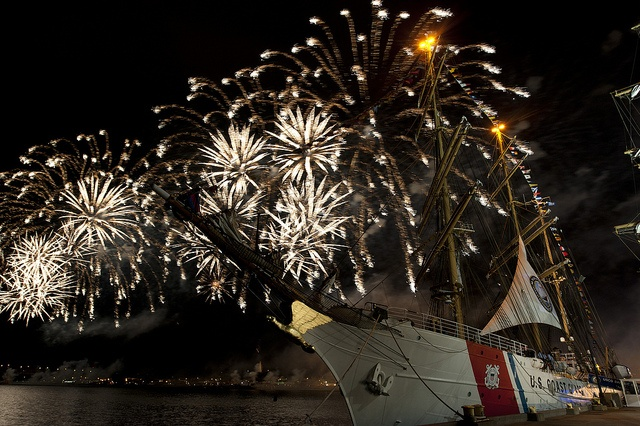 In this photo provided by the U.S. Coast Guard, a fireworks show is displayed during OpSail 2012 in Fort Trumbull in New London, Conn., Saturday, July 7, 2012, while the U.S. Coast Guard Cutter Eagle is moored to a pier. Eagle, its crew and U.S. Coast Guard Academy cadets sailed from Niantic, Conn., to make a port call during the commemoration of the 200th anniversary of the War of 1812. U.S. Coast Guard photograph by Petty Officer 3rd Class Diana Honings. #coastie #coastguard