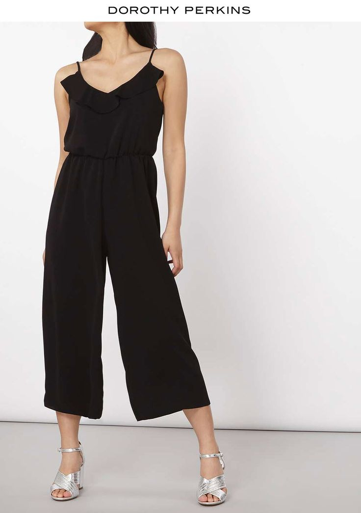 Petite black jumpsuit with ruffle detail and spaghetti strap is your answer to summer dressing. #summeroutfit