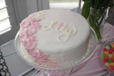 Simple pink and white fondant flower cake for girl's birthday.
