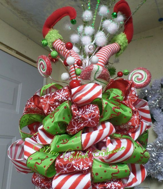 Here is my FAVORITE tree topper thus far!. This little Elf had a crash landing right into the top of your tree. The topper is made with whimsy