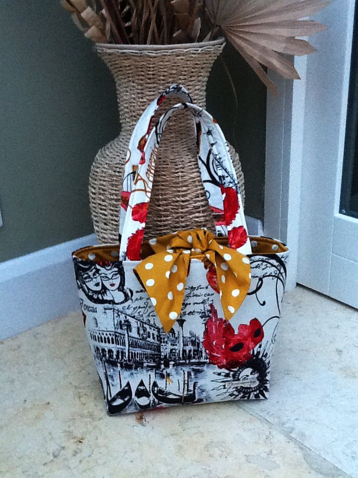 """This is our """"Karen"""" bag and comes with a different interior, compact pocket, pen pocket and key clasp. It is tie fastening and is sized approx. 300mm x 250mm. Price £30 (+postage £6)"""
