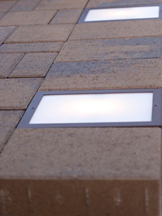 The Nox Lighting Cored LED Paver Lightis designed to be recessed into pavers, stone, decks or any other outdoor surface.