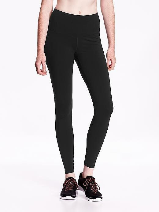 Basic, stretchy, high-rise black leggings belong in every active gal's closet. These go with everything, an...