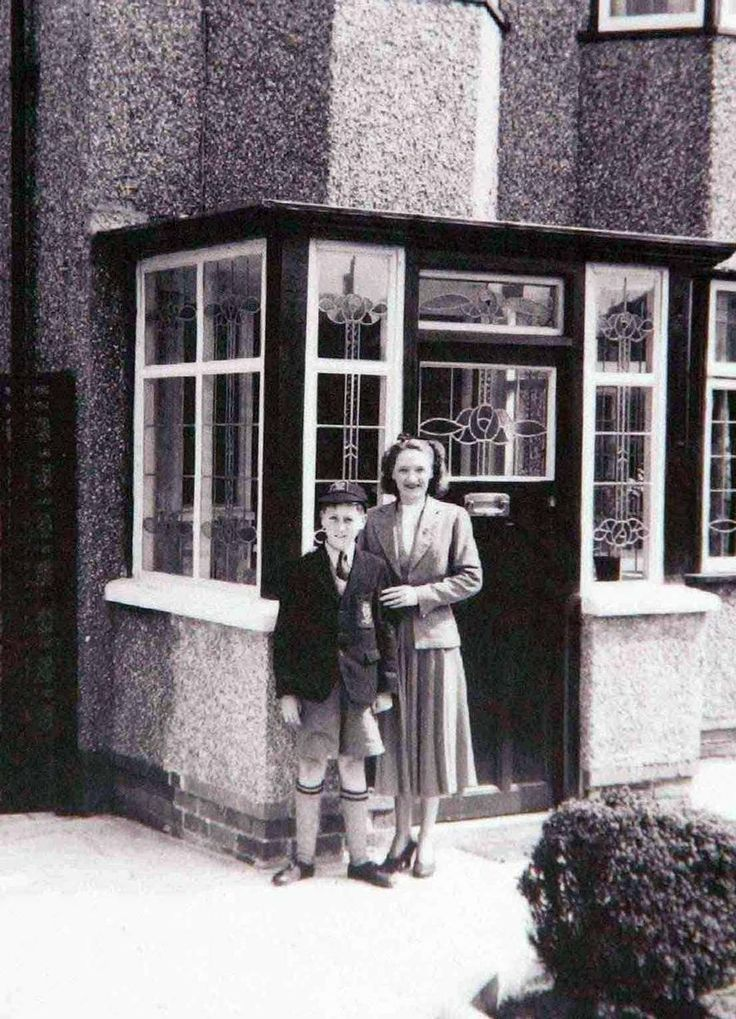 Former Beatle John Lennon as a young boy outside his childhood home of Mendips with his aunt Harriet. The house on Menlove Avenue, Liverpool is now owned by the national trust and is open to the public