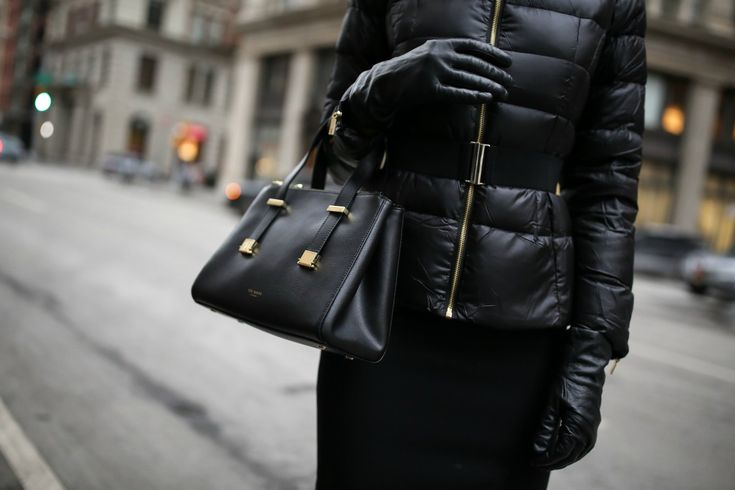 Mary Orton of fashion blog Memorandum layers a professional puffer coat over a black pencil skirt