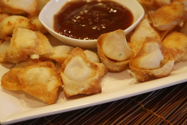 This crispy wontons appetizer recipe is filled with cream cheese and fresh crab.  Great served with plum sauce for dipping.  Photos included.