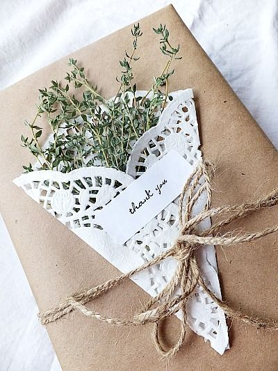 Brown Wrapping Paper Ideas  From http://bluepurpleandscarlett.com/2012/04/24/8-ideas-for-simple-wrapping-with-herbs-and-paper-doilies