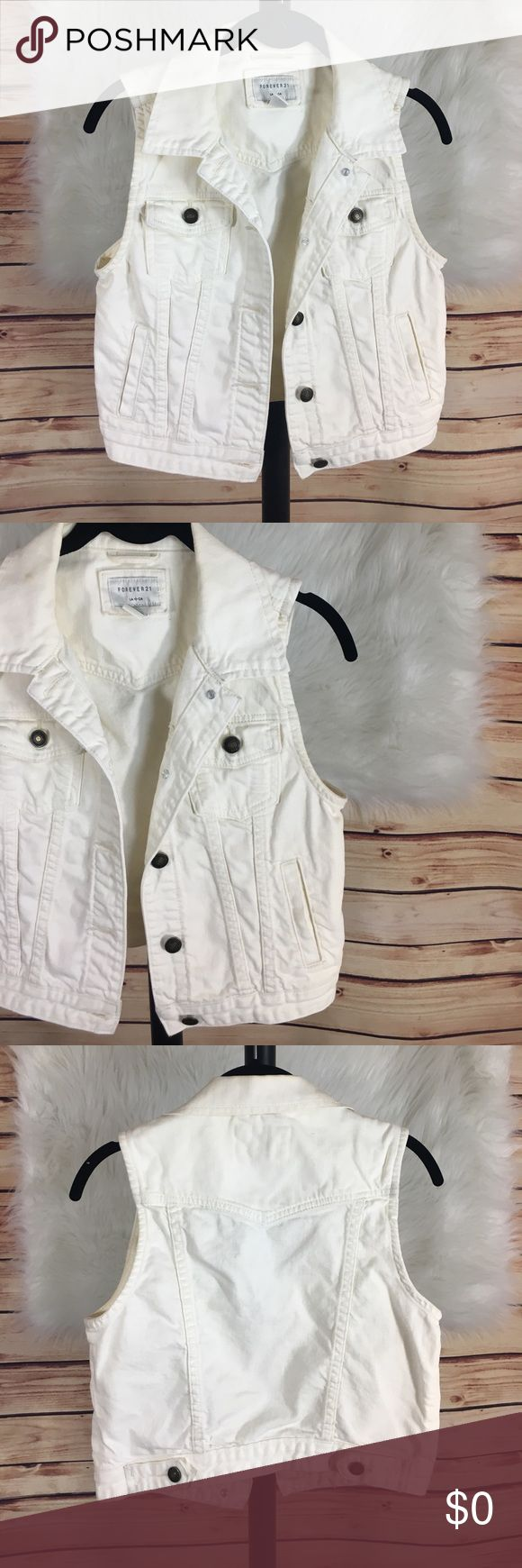 "✨ Forever 21 white denim jacket / vest ✨Newly listed items are priced to move.. please help me clear out my actual closet 😉 Brand: Forever 21 Size: S Type: white denim jacket / vest  Details: all front bronze buttons function, four front pockets  Bust measurement: 15.5"" across (closed) Length from collar to bottom: 15"" Length from shoulder to bottom: 20"" Condition: preloved: good *small mark on collar as pictured    ✨Build a bundle with all your likes and use the automatic bundle discount…"